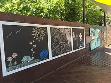 Chalk drawings on wooden fence