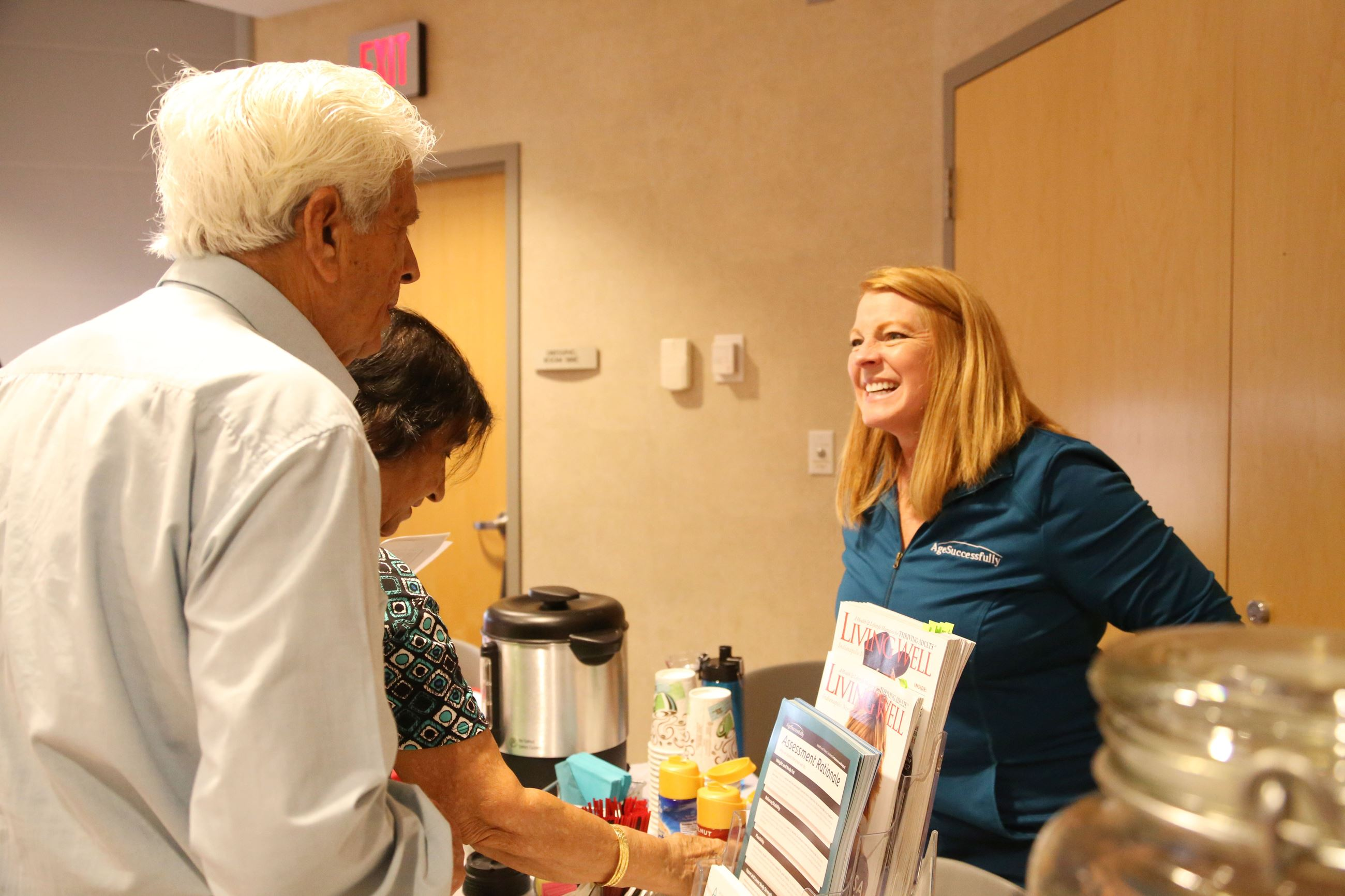 Two adults talking at the senior expo.